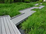 Use A Wooden Garden Walkway To Span A Garden Area