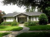 The well-trimmed hedges and lawn compliment this cute bungalow. The ...