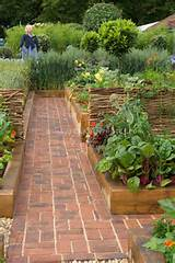 Vegetable garden with brick pathway and girl scarecrow | Plant ...
