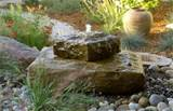 small outdoor fountain such as this pondless one is perfect for
