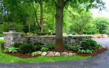 mortared granite wall and column beautifies a driveway entrance and