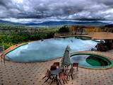 ... pool and baby pool all look onto beautiful natural landscape in this