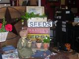 ... out our store for primitive signs, gardening dolls, and birdhouses