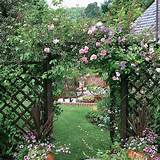 Wooden archway with flowering plants, beautiful yard landscaping ideas