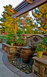 outdoor-fountain-in-mediterranean-landscape-with-concrete-patio-ideas ...