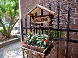 Creative DIY garden container ideas - Planter made of twigs on iron ...