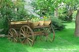 rustic horse drawn wagon used as garden decor and decoration