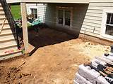 paver patio under deck with retaining wall steps a photo on