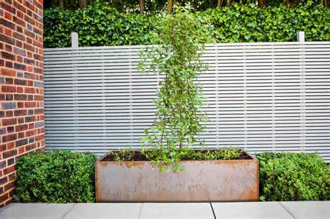 garden fence design ideas with exposed brick wall : OLPOS Design
