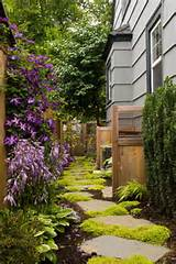 materials in varied heights enhance a path through a narrow side yard