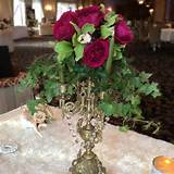 Candelabra centerpiece with cymbidium orchids & garden roses