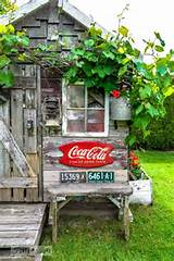 Coke sign and vintage license plates / Rustic garden shed with old ...