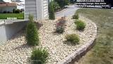 front landscape beds with river stone new plants stone edging