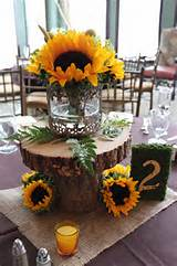 Kristin used our bark flower pedestals and also rented these fun metal ...