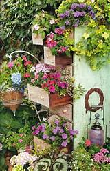 repurposed garden containers tons of great ideas for your plants the