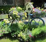... beautiful garden – I am loving all her flowers and her garden decor