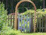There is a bright sunny face on the garden gate that gives a warm ...