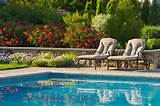 Formal swimming pools by Cording Landscape Design.