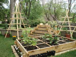 Stacked raised beds and trellis vertical gardens. | The Micro Gardener