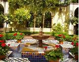 Small garden design with colorful tiles and water fountain