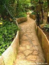 garden paths retaining wall enclosed garden path idea