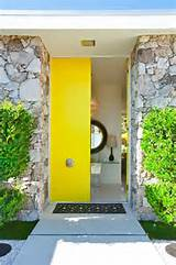 Entrance with a surprising yellow pop of color and a lucite table just ...