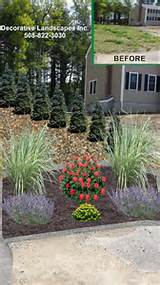 side yard landscape design with riverstone planting bed and privacy