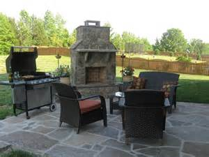 Stone outdoor fireplace with stone patio in Charlotte, NC