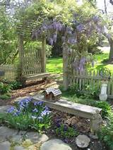 Love the fence, the bench, and the birdhouse. The blue flowers are ...