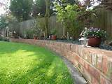 Garden Edging And Aged Light Brown Brick Garden Wall. Garden Brick ...