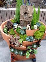 fairy garden or gnome garden idea from a broken terra cotta pot with