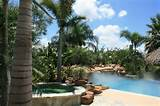 residential pool landscaping and palapa tropical landscape