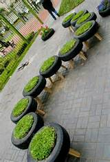 Garden in tires idea | Business ideas | Pinterest
