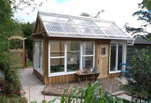 Clear awning roof allows lots of light to enter this greenhouse made ...