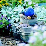 this is an easy charming water fountain done with stones and