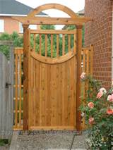 wooden gates with curved features