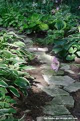 natural random flagstone garden path.