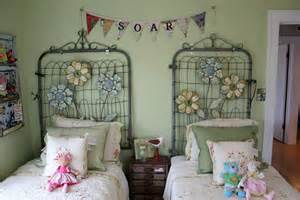 old garden gates as headboards and garden edging fence as a valance