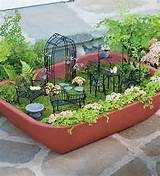 walled self watering herb garden planter with fairy garden furniture