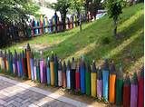 these colorful fences look like giant colored pencils in a box