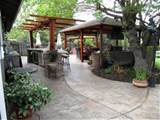 spacious patio design with a covered seating area