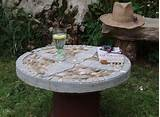 diy table top made of concrete and pebbles mosaic
