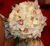 bridal bouquet with cymbidium orchids garden roses roses and calla