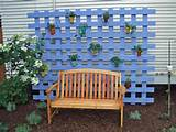 Hide the electric box, add a planter box with trellis