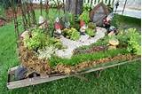 Gnome Garden in an old wheelbarrow-Bachmans Summer Idea House 2011