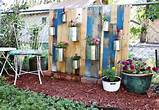 created a vertical garden from recycled pallets the chain link fence