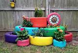 painted tire planters loving all the color via lemon bean and