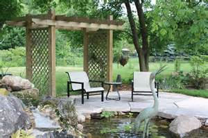 small lattice pergola pond patiocanada landscapinglads landview