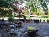 quiet zen garden walkway with rock water feature hgtv