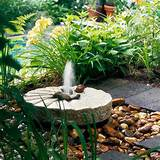 Millstone Fountain...garden fountain ideas